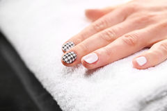 Chanel grille, black and white pattern on your nails Stock Photo