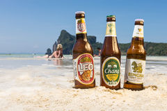 Chang,Singha and Leo beer on the beach Royalty Free Stock Photos