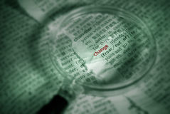 Change. Find word of change in papers with magnifier in green color stock images