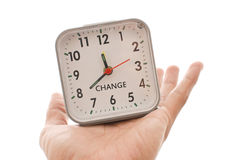Change. Time for a Change With A Clock In A Male Hand royalty free stock photos