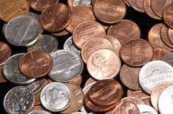 Change. A color photo of pennys nickles dimes and quarters Royalty Free Stock Photos
