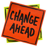 Change ahead reminder note. Change ahead warning, reminder or advice, - handwriting in black ink on an isolated sticky note royalty free stock image