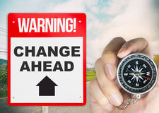 Change Ahead sign with compass. Change Ahead signage with compass for Direction stock images