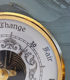 Change in the air. Close-up on an old barometer, set in a block of volcanic ash Royalty Free Stock Photos