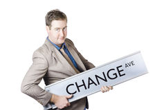 Change Ave. Business improvement and evolution. Cool businessman rocking out on change avenue in a business improvement and evolution concept Royalty Free Stock Image