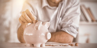Change being put into piggy bank Royalty Free Stock Photography