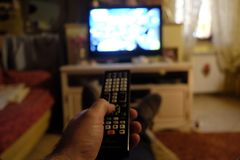 Change channel with the remote control Stock Image