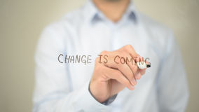 Change is Coming, man writing on transparent screen stock images