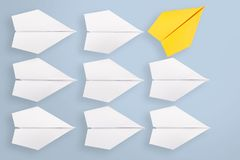 Change concept with yellow paper airplane. Working Royalty Free Stock Images