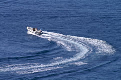 Change course. Motorboat changing course  at full power leaving curved wake behind Royalty Free Stock Photography