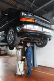Change engine oil and transmission inspection Stock Image