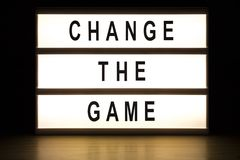 Change the game light box sign board. On wooden table royalty free stock images