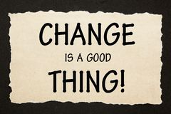 Change Is A Good Thing. Text on old torn paper on black background. Motivation concept stock images