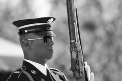 Change of the Guard in Arlington Cemetery. Marine with glasses and rifle during change of the Guard in Arlington Cemetery - converted in black and white for more Stock Photos