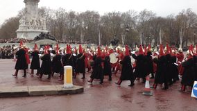 The change of the guard - London - UK. LONDON - DECEMBER6: ceremony of the changing of the guard at Buckingham Palace with the parade of the royal guard on stock video footage