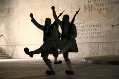 Change of guard at the Monument to the Unknown Soldier in Athens. ATHENS, GREECE - SEPTEMBER 19, 2012: These are silhouette of soldiers during the ritual of Stock Image