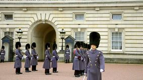 Change of guards at the Buckingham palace, London stock video footage