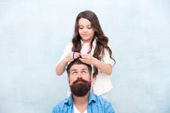 Change hairstyle. Create funny hairstyle. With healthy dose of openness any dad can excel at raising girl. Child making. Hairstyle styling father beard. Being stock photo