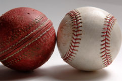 Change Happens - Cricket to Baseball. Baseball and Cricket ball. Cricket dates from the 13th century and was the precursor of Baseball which debuted in America royalty free stock photography