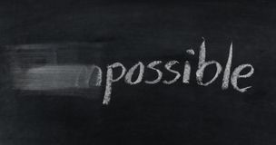 Change impossible to possible  on blackboard Royalty Free Stock Images