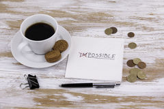 Change impossible to possible. Handwriting on a napkin with a cu Stock Photos