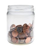 Change jar. A jar of loose US coins, isolated on a white background stock photos