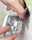 Change light switch, connect the wires from  house wiring. Stock Images