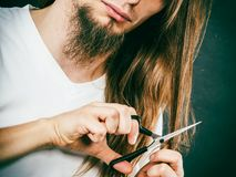 Male hands cutting long hair Stock Photo