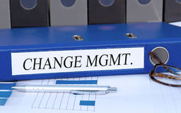 Change Management, blue binder with text in the office. Change Management, blue binder with text and pen on desk in the office stock photos