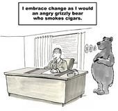 Change Management. Cartoon shows a businessman in his office who does not realize it yet but change (in the form of a grizzly bear smoking a cigar) is upon him Stock Photos