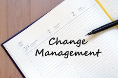 Change management write on notebook Stock Photography