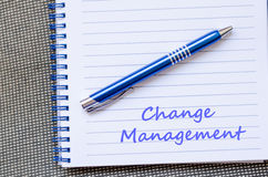 Change management write on notebook Stock Photos