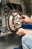 Change new brake pads. In progress Stock Photos