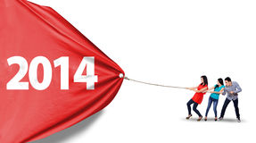 Change new future concept. Group of friends is pulling new year of 2014 to change the new future Stock Photography