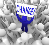 Change - Person Holding Sign in Crowd. A blue person stands out in a crowd holding a sign reading Change royalty free illustration
