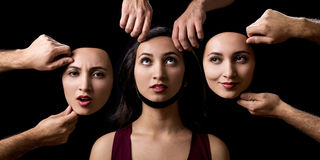 Change of personality on black background. Hands of man making change of personality in woman character royalty free stock photo