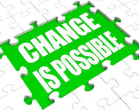 Change is possible jigsaw. Abstract jigsaw background with change is possible incomplete in center Stock Image