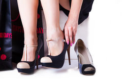 Change shoes woman Royalty Free Stock Photography