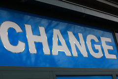 Change signboard on the wall Royalty Free Stock Image