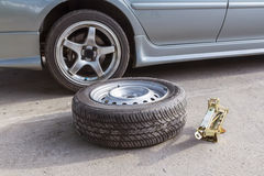 Change spare wheels Stock Photography