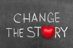Change the story. Phrase handwritten on chalkboard with heart symbol instead of O Royalty Free Stock Image
