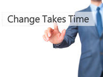 Change Takes Time - Businessman hand pressing button on touch sc. Reen interface. Business, technology, internet concept. Stock Photo royalty free stock images