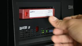 Change tape from the tape drive on Computer Server stock video