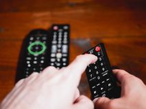 Change television channel with finger in remote control stock images