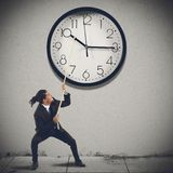 Change the time. Move clock hands to change the time Royalty Free Stock Photography