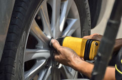 Change the tires or wheel with auto screw. Change the tires or wheel with auto screw in automobile repair shops (Selective focus&#x29 Royalty Free Stock Image