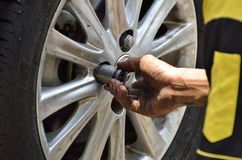 Change the tires or wheel with auto screw. Royalty Free Stock Image