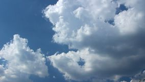 Change Weather Conditions, Dark Stormy Sky, Clouds Running Across the Blue Sky, Timelapse of Vast Puffy Fluffy White Clouds