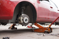 Change wheels. Changing car wheels on the road Stock Photography