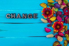 Change word on blue wood with flower. Change word on old blue color wood with flower and dried flower royalty free stock photo